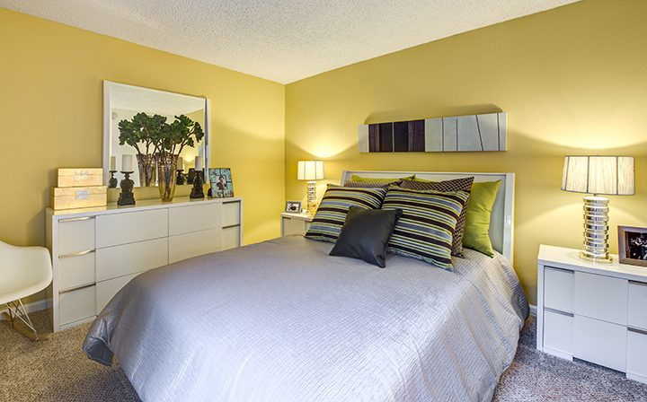 Cozy furnished bedroom with carpeting at Alura, a Woodland Hills apartments community