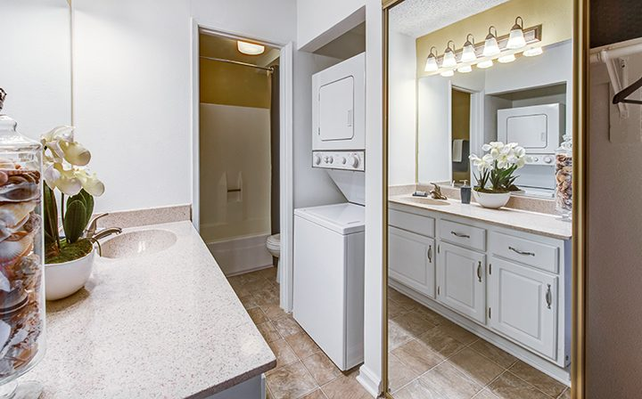 In-unit washer and dryer in furnished bathroom at Woodland Hills apartments community Alura
