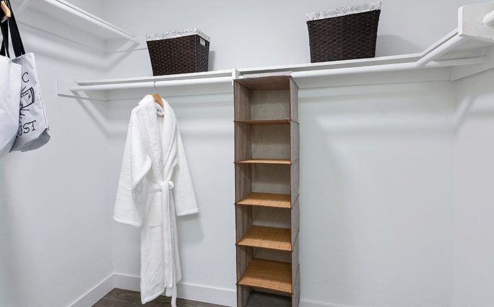Large walk-in closet with overhead shelf space at Woodland Hills apartments community Alura