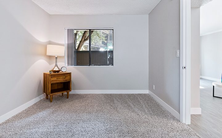 Renovated bedrooom with ample natural light from window at Woodland Hills apartments community Alura