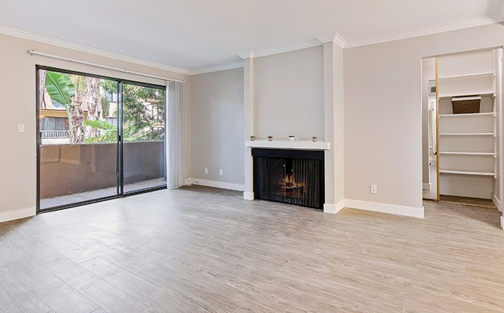 Balcony exit and fireplace in renovated living room at Alura, a Woodland Hills apartments community