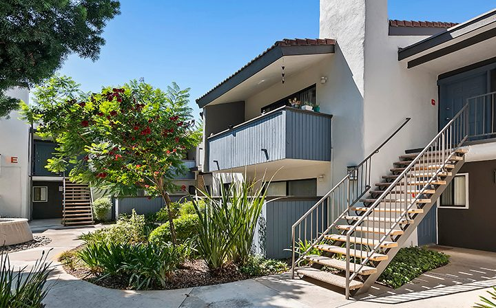 Courtyard pathway and unit exteriors at Alura, a Woodland Hills apartments community