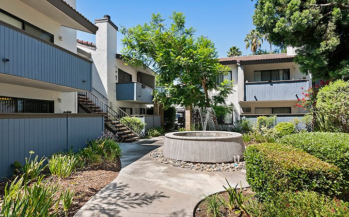 Courtyard fountain and path at Alura, a Woodland Hills apartments community