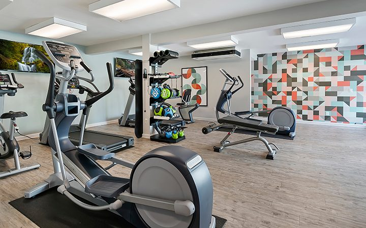 Assorted weight and cardio machines at the Woodland Hills apartments Alura fitness center