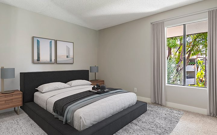 Furnished bedroom in model unit at Woodland Hills apartments community Alura