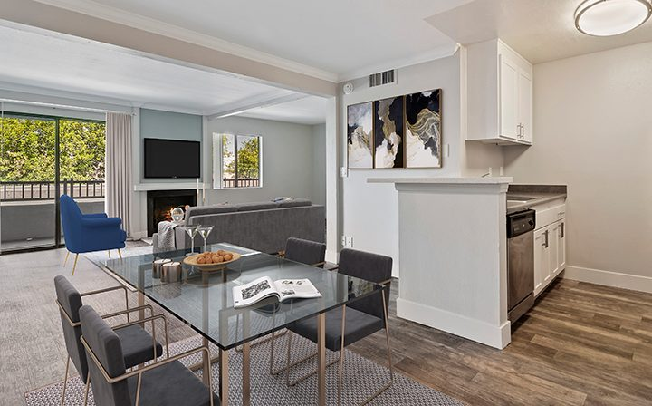 Furnished dining area and living room at Woodland Hills apartments community Alura