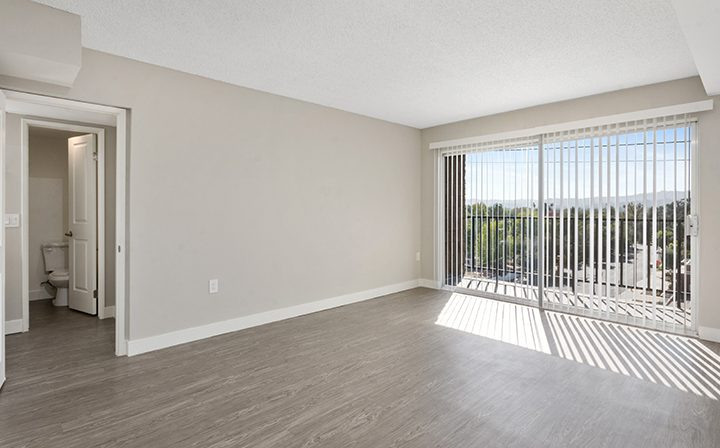 Sunny living room interior at Amanda Regency, Decron's San Fernando Valley apartments