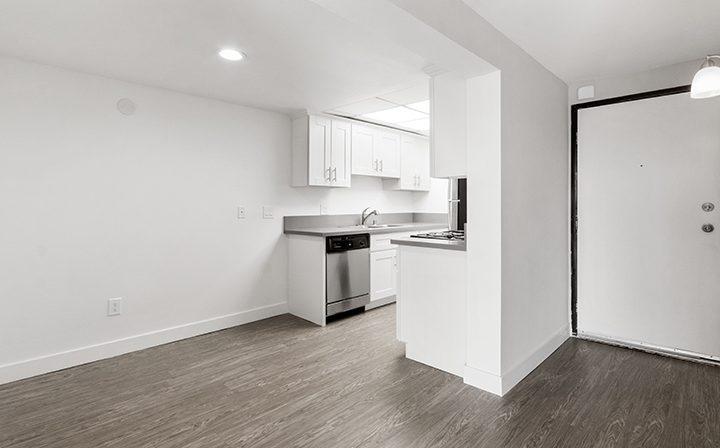 Apartment door and kitchen nook at Amanda Regency, Decron's San Fernando Valley apartments
