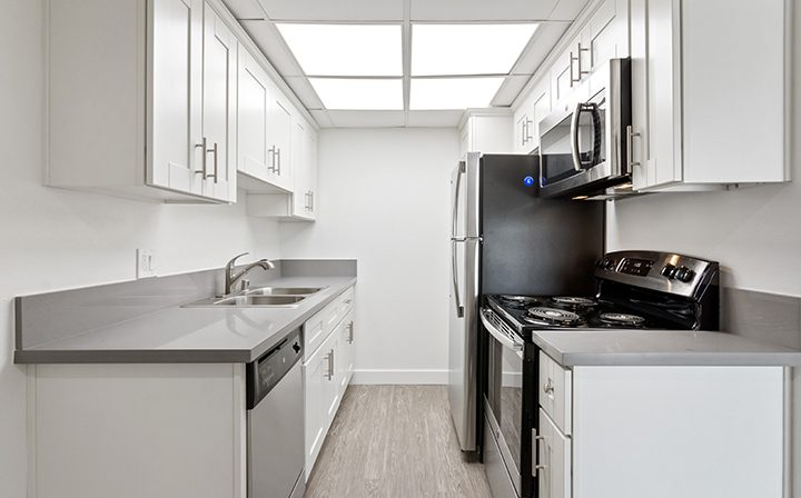White kitchen with skylight at Amanda Regency, Decron's San Fernando Valley apartments