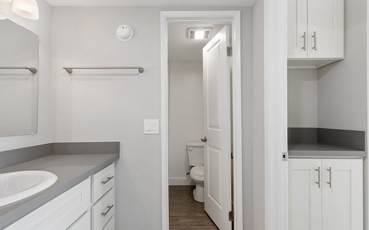 White unfurnished bathroom at Amanda Regency, Decron's San Fernando Valley apartments
