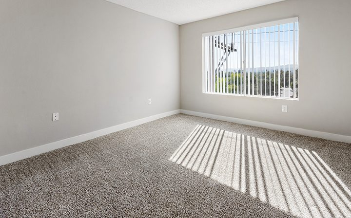 Unfurnished bedroom with bright window at Amanda Regency, Decron's San Fernando Valley apartments