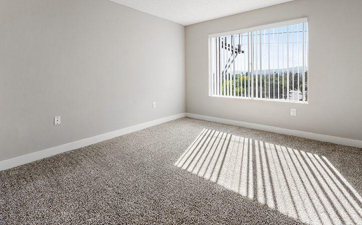 Unfurnished bedroom with bright window at Amanda Regency, Decron's San Fernando Valley apartments