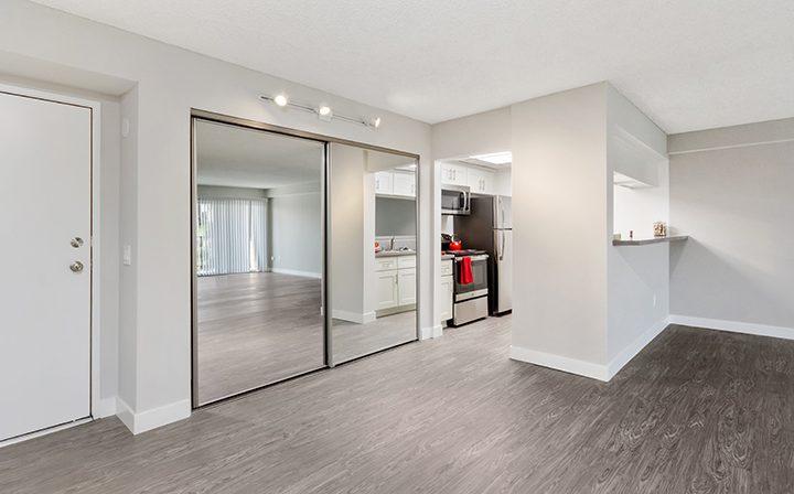Mirrored closet next to kitchen nook at Amanda Regency, Decron's San Fernando Valley apartments