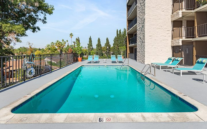 Direct view of resort-style pool at Amanda Regency, Decron's San Fernando Valley apartments