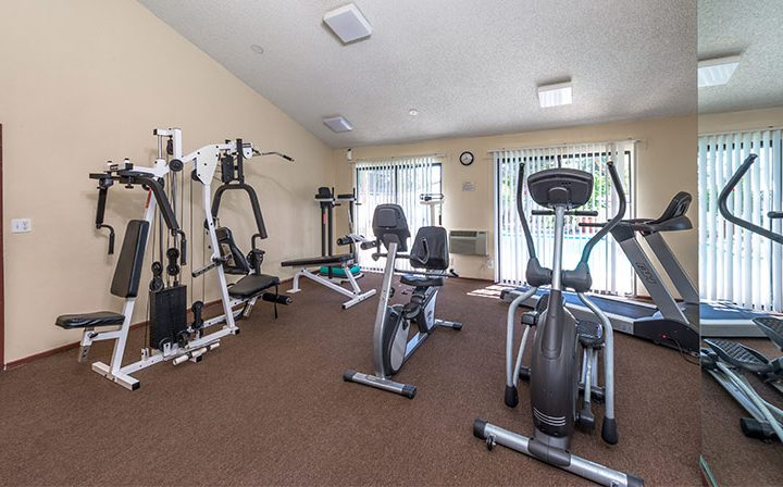 Cardio and strength machines at Westwood apartments community Ariel Court's fitness center