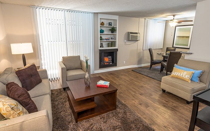 Furnished apartment living room with fireplace at Ariel Court, Westwood apartments near UCLA
