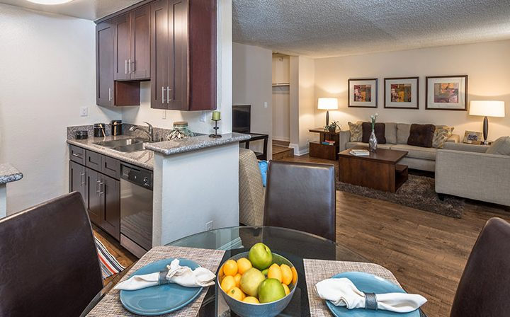 Table setting and furnished living room at Ariel Court, Westwood apartments near UCLA
