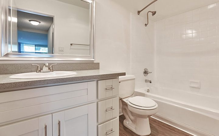 Unfurnished white bathroom with shower/tub combo at Ariel Court, Westwood apartments near UCLA