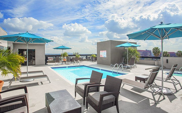 Stunning cloudy sky above rooftop pool at Ascent, West Hollywood apartments in Los Angeles county