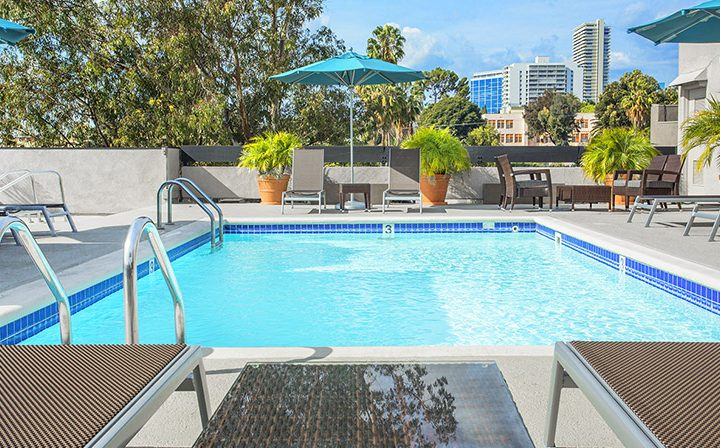 Rectangular rooftop pool and outdoor seating at the West Hollywood apartments community Ascent