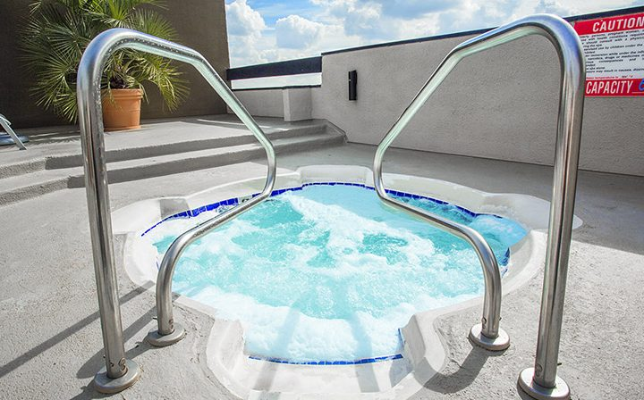 Frothy hot tub near rooftop pool at Ascent, West Hollywood apartments in Los Angeles county