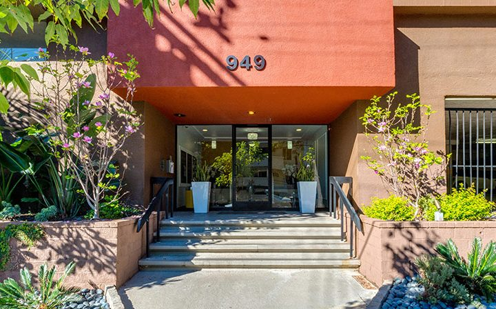 Streetside exterior view of the lobby entrance to the West Hollywood apartments community Ascent
