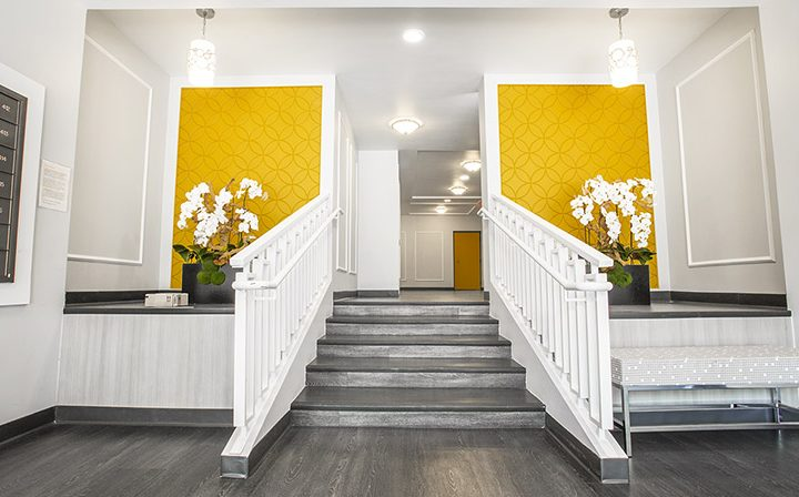 Stylish white and grey lobby interior at Ascent, West Hollywood apartments in Los Angeles county