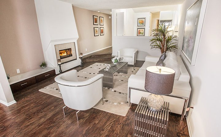 Furnished interior with a fireplace and seating at the West Hollywood apartments community Ascent