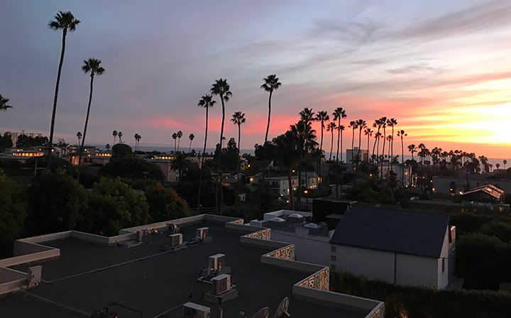 Sunset view of the city from a balcony at the Pacific Ocean community, Santa Monica apartments