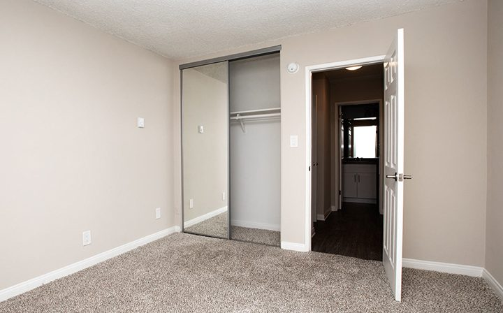 Unfurnished bedroom with mirrored closet at the Pacific Ocean community, apartments in Santa Monica