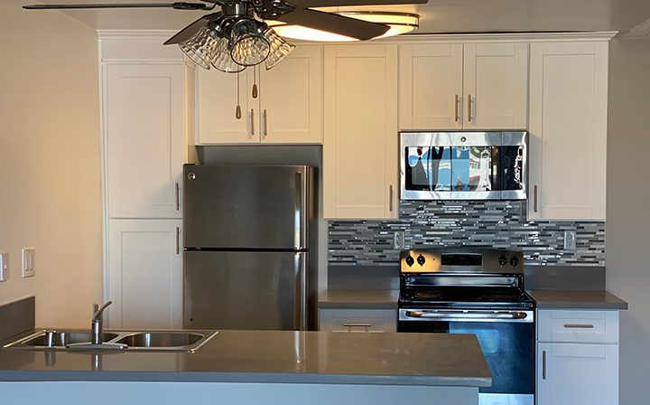 Unfurnished kitchen with white cabinets at the Pacific Ocean community, Santa Monica apartments