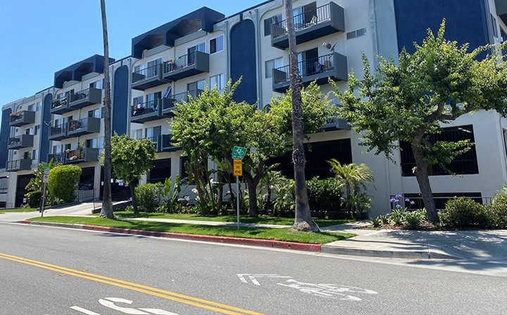 Streetside view of the Pacific Ocean community, apartments in Santa Monica with blue accents