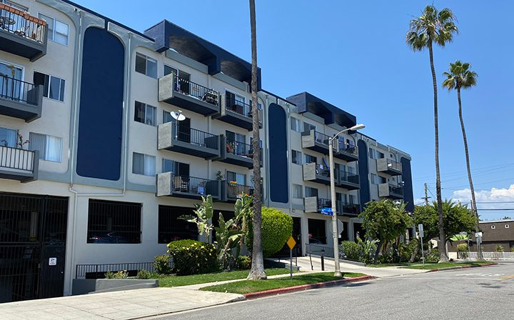 Streetside view of the Pacific Ocean community, Santa Monica apartments with blue accents
