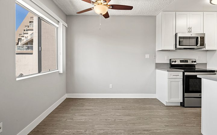 Living room and kitchen in a 1x1 unit at the Bay on 6th community, apartments in Santa Monica