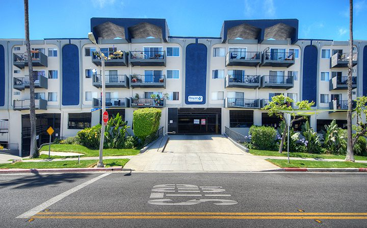 Streetside view of the Bay on 6th community, apartments in Santa Monica with blue accents