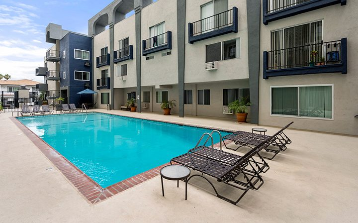 Pool and chairs by the Bay on 6th community, apartments in Santa Monica