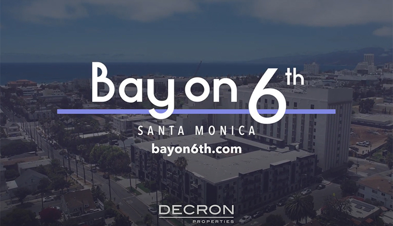 Aerial city video still text overlay: Bay on 6th - Santa Monica - beyond6th.com - Decron Properties