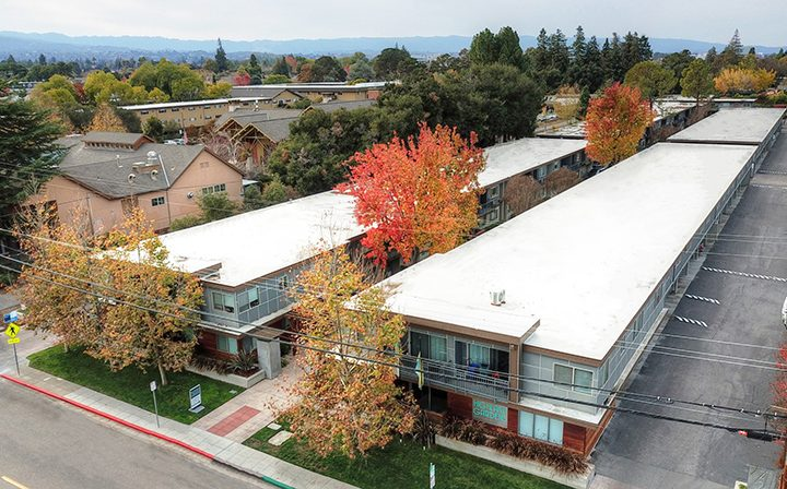 Aerial view of Highland Gardens Mountain View apartments split by pathway and trees with fall colors