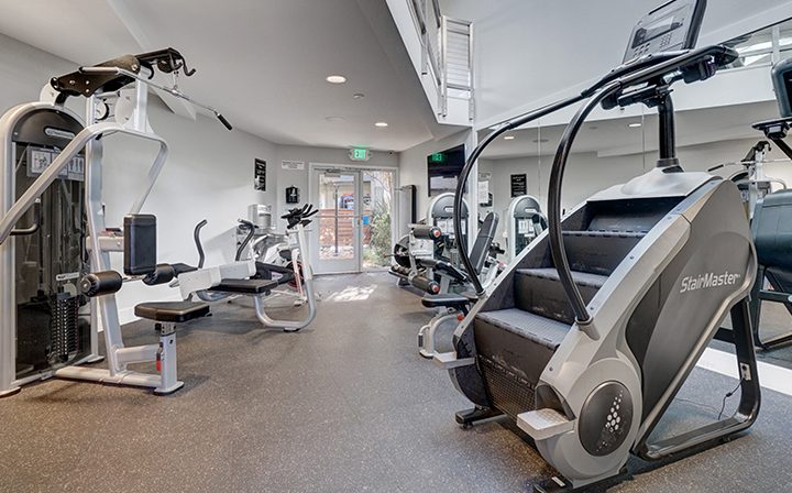 Cardio and weight machines at Mountain View apartments Highland Gardens' fitness center