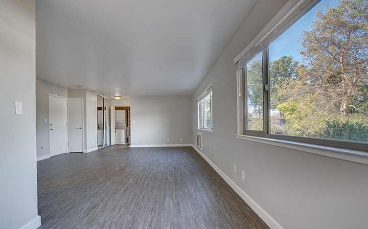 Unfurnished living room hallway with forested view at Mountain View apartments Highland Gardens