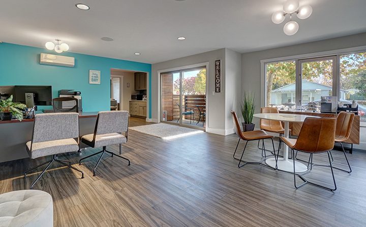 Mountain View apartment community Highland Gardens' leasing office interior with hardwood floor