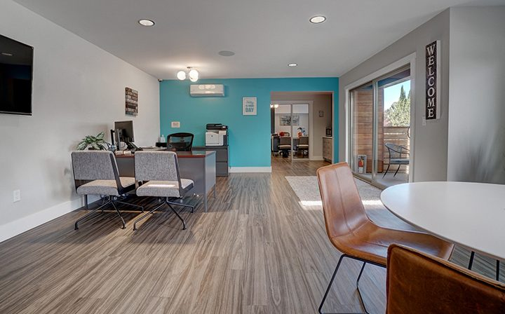 Leasing office interior with aqua accent wall at Mountain View apartment community Highland Gardens