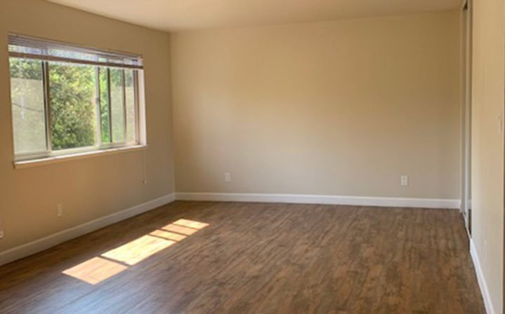 Bright unfurnished room at Mountain View apartments community Highland Gardens