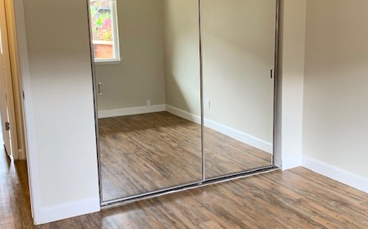 Mirrored closet in unfurnished bedroom at Mountain View apartments community Highland Gardens