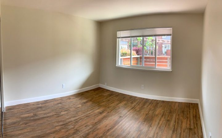 Large window in unfurnished bedroom at Mountain View apartments community Highland Gardens