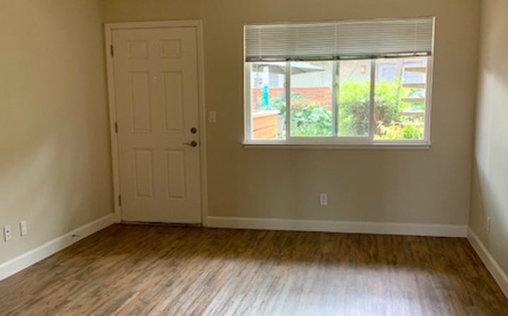 Unfurnished room with door to Mountain View apartments community Highland Gardens