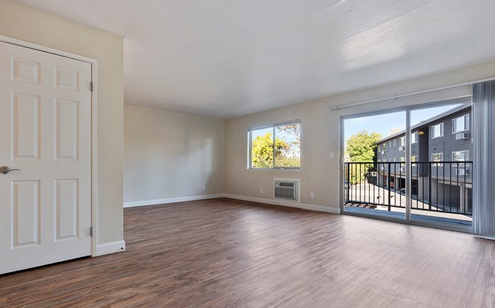 Unfurnished living room and balcony at Mountain View apartments Highland Gardens