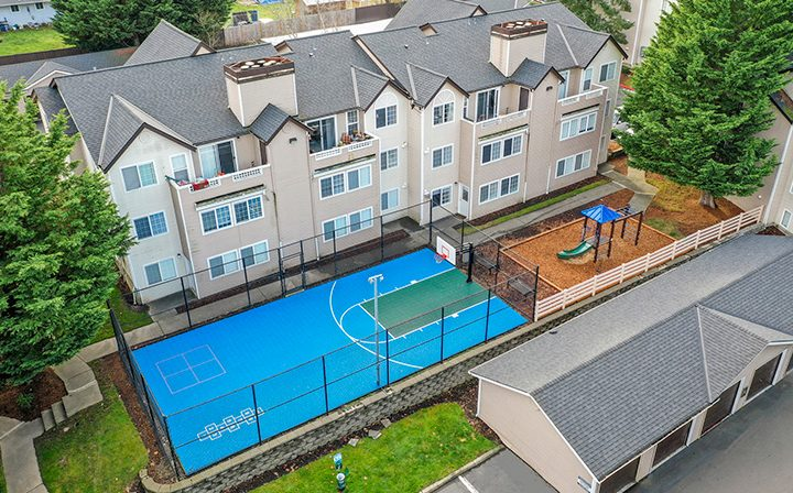 Aerial view of Kent, Washington apartments at Indigo Springs, with basketball court and playground