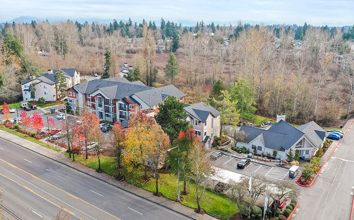 Aerial view of cozy Indigo Springs apartments in Kent, Washington amid beautiful fall landscape