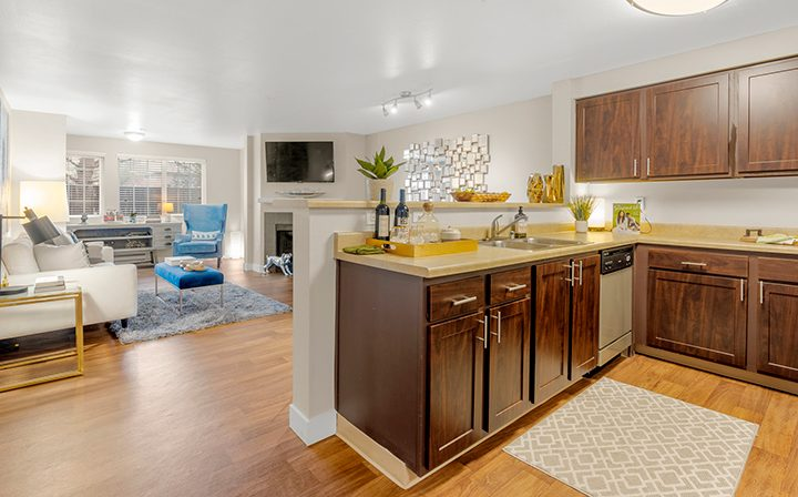 Furnished living room and kitchen with hardwood floors at Indigo Springs apartments in Kent